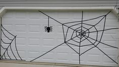 Halloween garage door spiderweb using electrical tape Garage Halloween Party, Garage Door Halloween Decor, Garage Door Decor, Halloween Door Decorations, Outdoor Halloween, Holidays Halloween, Halloween Diy, Garage Doors, Halloween Designs