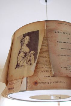 Enlarged pages of an old book attached to an IKEA lamp (via Design*Sponge)