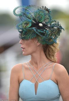 Elaborate  A lady arrives for the races in a simple duck egg blue dress and 562df09d4b4