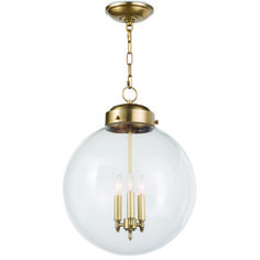 This oversized clear glass globe has a surprise inside: 3 light mini chandelier in Bronze with Antique Brass, Polished Nickel or Antique Brass. Over a kitchen island or in an entry hall, it will become a permanent favorite. Globe Pendant Light, Pendant Lighting, Gold Pendant, Mini Chandelier, Hanging Lanterns, Or Antique, Candelabra, Polished Nickel, Clear Glass