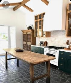15 Farmhouse Style Decor Ideas to Get You Started Love this reclaimed wood kitchen island table. Green kitchen cabinets, wood beam ceiling, and gray tile kitchen floor. Grey Kitchen Tiles, Green Kitchen Cabinets, Kitchen Island Table, Kitchen Flooring, Dark Cabinets, Kitchen Black, Kitchen Backsplash, Kitchen Prep Table, Green Kitchen Island