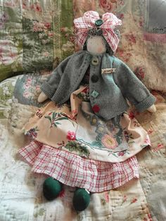 Another pinner said:  Handmade rag doll - Daisy. I say:  I don't think of her as a rag doll as much as I think she reminds me of the women in the 50's with their hair tied up...doing their housework...and then they would get all dressed up right before hubby came home.
