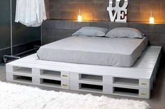 White Painted Pallet Platform Bed - 25+ Renowned Pallet Projects & Ideas | Pallet Furniture DIY - Part 2