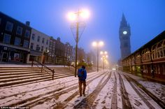Wrapping up warm: People walk in the white town centre of Darlington, County Durham, early this morning after more snow was brought to England overnight [Dec 2012]