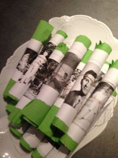 Photographs used as napkin rings is a memorable 50th birthday party idea.  See more planning a 50th birthday party ideas at www.one-stop-party-ideas.com
