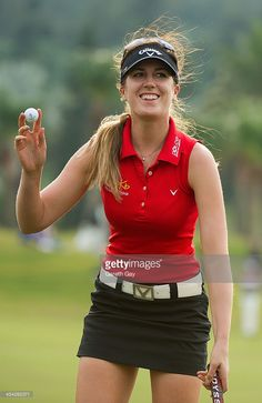 News Photo : Sandra Gal of Germany, collects her golf ball...