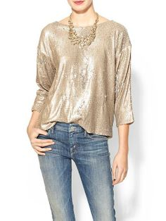 Sparkle shine glitter holiday top with classic denim jeans