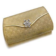 Gold and diamond evening bag Of basket woven yellow gold, the thumbpiece of floral design set with single-cut diamonds, opening to reveal a mirror, measurements approximately 185 x 90 x 55mm, Italian maker's mark, gross weight approximately 351 grams.