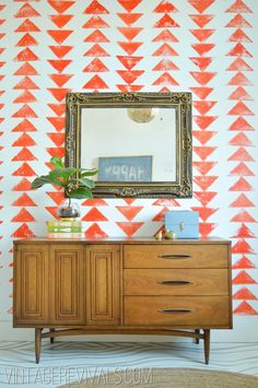 faux bois painted floor, stenciled triangles on wall, awesome mid century dresser