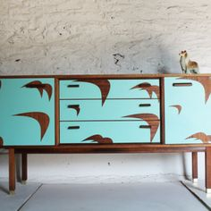 Trendy Retro Cabinet, painted with 'tattoos on it.