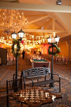 NYC-themed holiday party at Waterview in Monroe, CT - Central Park benches and lamp post decor, chess board entertainment and games, pool table, holiday decor and lighting. #powerstationevents #evententertainment #eventdecor #eventlighting