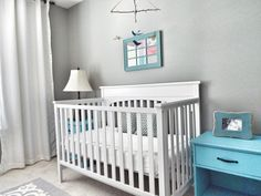 Cute DIY bird mobile in this Aqua and Gray Bird-Themed Nursery
