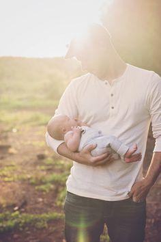 father and son newborn pose