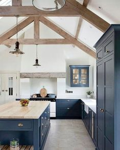 2020 Paint Trend: 5 Classic Blue KitchensBECKI OWENS What's Decoration? Decoration could be the art of decorating the interior and … Farmhouse Kitchen Island, Kitchen Islands, Country Kitchen, Kitchen Counters, Blue Kitchen Cupboards, Industrial Farmhouse Kitchen, Blue Kitchen Island, Navy Cabinets, Upper Cabinets