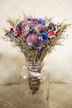 Bold arrangements of wildflowers in Mason jars are a lovely, rustic detail | Kathleen Hertel Photography