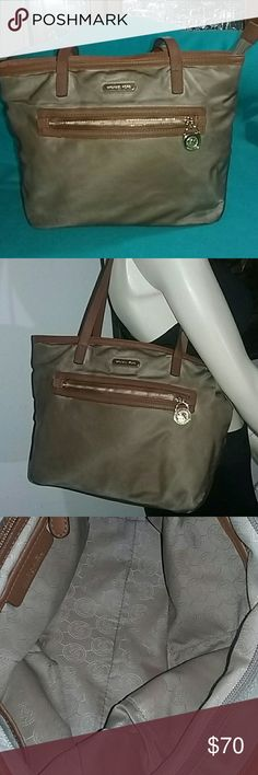 Authentic Michael Kors Shoulderbag Nylon with genuine leather strips and bottom drop, big and spacious large zipper pocket on the front. Very clean and undamage. Michael Kors Bags Shoulder Bags