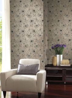 Soft metallic inks glow in a well lit room.  Width: 27 in  Repeat: 24 in  Length: 13.5 ft (SINGLE ROLL)  pre-pasted, washable, strippable  metallic silver background with sketched roses outlined in black $32.95 per single roll. http://lelandswallpaper.com