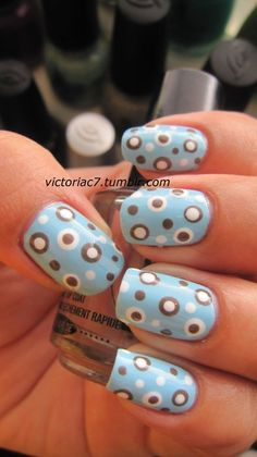 Mod Double Polka Dots - DIY Nail Nail Art Designs.     First apply a sky blue base color, and using either a bobby pin or the tip of an old pen and carefully make polka dots in different sizes using brown and white. After this layer dries, go back and add a smaller dot of the opposite color inside of the larger ones you just made. Apply and topcoat and you're done!