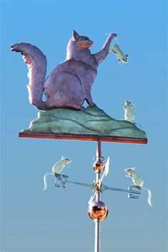 Maine Coon Cat Weather Vane with Mice by West Coast Weather Vanes. In this handcrafted Maine Coon cat weathervane we customized with optional gold leaf to the Coon Cat's Whiskers and made each of the mice golden as well. Gatos Maine Coon, Maine Coon Cats, Crazy Cat Lady, Crazy Cats, West Coast Weather, Lightning Rod, Cat Signs, Weather Vanes, Cat Mouse