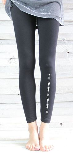 Stylish black leggings featuring an understated, reversed out arrow print to lower left leg. I think I will take up archery soon! ;-) ♥