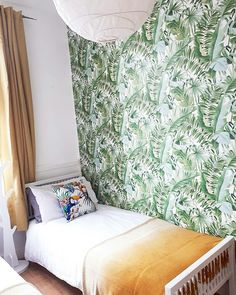 Boys bedroom leaf wallpaper  and mustard yellow ombre blankets