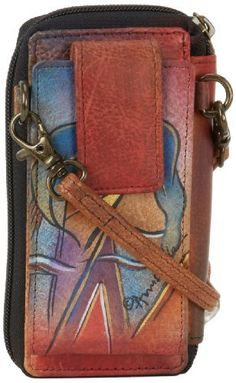 Anuschka 1101 Wallet,Hidden Window,One Size Anuschka. $90.76. Snap button flap entry to cell pocket. Zip around entry to compartment with 1 ID window, 7 CC holders, 1 coin pocket, 2 slip in pockets. Detachable strap with 22 drop. Save 10% Off!