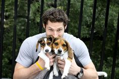 Troy Brouwer and his dogs for the Caps players/dogs calendar.  too presh.