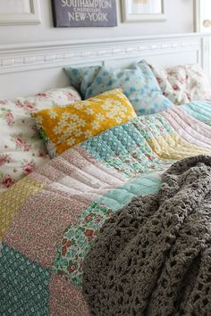 I'm not sure what this blog is about but I LOVE this quilt and the play of colours with the simple cushions. It's a simple patchwork quilt - just squares of your favourite fabrics. You can quilt it yourself with just simple lines of stitching and then add some chunky yarn, and cushions. It's like sunshine.