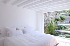 Likes: big window, simple white, white ceiling beams, view into the garden. Casita?