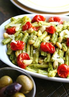 Kale Pesto Pasta with Roasted Tomatoes and White Beans is a simple, flavorful…