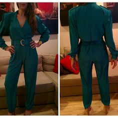 Amazing teal 80s jumpsuit Stunningly slinky elegant jumpsuit with beautiful detailing. Gathered waist with zipper and front side button which helps create the perfect neckline. Shoulder pads add to the drama but can be easily removed and gold buttons on the epaulettes and cuffs lend some glamor. The back drapes beautifully with an almost cape like detailing. Fits like a 4. Model measurements 32 26 35 Vintage Pants Jumpsuits & Rompers