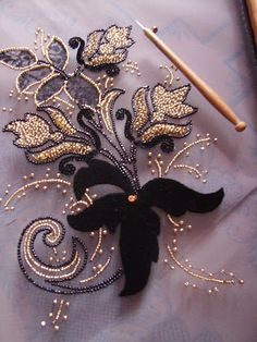 An example of embroidery (here a model Carole Magne), which is little to do with the luneville hook (small tool in the photo), the pattern is made from beads, sequins, and lace and inscrutation velvet. Tambour Beading, Tambour Embroidery, Couture Embroidery, Embroidery Fashion, Silk Ribbon Embroidery, Beaded Embroidery, Embroidery Stitches, Hand Embroidery, Embroidery Designs