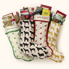 delightful Christmas stocking comes filled with a lovely hand chosen selection of dog products and includes: a toy suitable for chewing, a packet of treats, a grooming product and a charming Little Dog Laughed dog Christmas card The perfect Christmas gift for your best furry friend. www.hairofthedoglondon.com