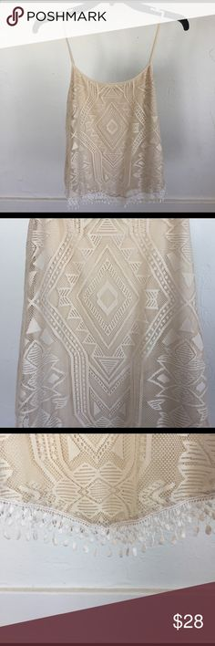 Gorgeous Aztec print cream tank top I don't there's a more gorgeous top out there! Seriously, this top is feminine and sexy, but classy with the cream color. Touches of edge with the Aztec print and the fridge bottom! What more could you want?! It's a large but could fit many different sizes with more or less room. Maurices Tops Tank Tops