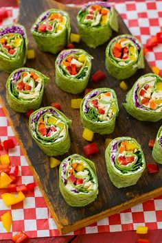 These veggie pinwheels are a rainbow of colorful fresh veggies with ranch flavored cream cheese, all rolled up inside a spinach tortilla wrap.