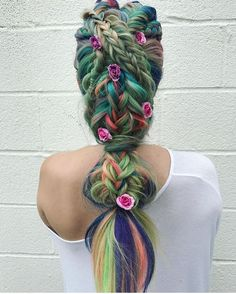 Dull rainbow hair colors in a mixture of braids and ties hairstyle | Braided hairstyle for opal unicorn hair | Mermaid Hair