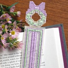 """Bookmark for Mom Plastic Canvas ePattern - For a mom who enjoys curling up with a good book, our pretty page keeper is a quick little gift to make for Mother's Day or any day. We stitched ours with pastel embroidery floss on white 10 mesh plastic canvas for a soft look. You could also use sport weight yarn.Number of Designs: 1 bookmark Approximate Design Size: 1-1/2""""w x 6-3/4""""h"""
