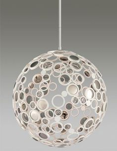 A handcrafted iron globe comprised of tiny circles with convex crystal disks, clear crystal lenses and open spaces, Corbett's Fathom is an e...