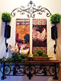 I like the overall design with the topper, sconces, and shelf but am not a big fan of the rooster theme.