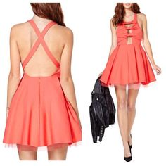 Sweet Charms Dress Front cut out with bow detail, inverted pleats, and volumizing tulle underlay. Zipper at back of skirt. Guava color. Rayon/Nylon/Spandex/Polyester. Great thick material. Very cute!!! $48 Nasty Gal Dresses