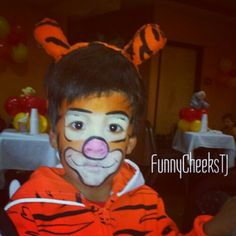 Face painting Tigger for Winnie the Pooh and Friends party by FunnyCheeksTJ