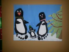 Christmas penguins family christmas. Paint the background first then add Mommies daddies and babies foot for penguins. Let feet dry then decorate as you wish.  Christmas tree is made with daddies hand on the bottom mommies the middle branch and babies on top and babies foot print as the stem.