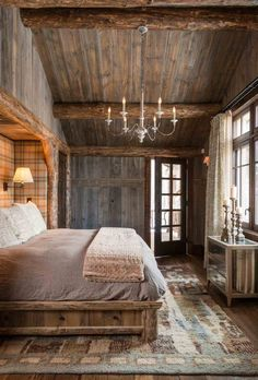 romantic rustic bedroom french countryside barn feel chandelier king size bed candles wooden beams