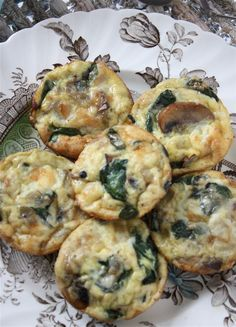Mushroom, Spinach   Mozzarella Mini Crustless Quiches  Makes 12 muffin-size quiches  Cooking spray  2 Tablespoons olive oil  1 small onion, diced  5 ounces fresh baby spinach  6 ounces crimini or button mushrooms, sliced  5 eggs  1 cup grated mozzarella cheese  1/2 cup 2 % milk  1/2 teaspoon Kosher salt  1/4 teaspoon freshly ground black pepper  Preheat the oven to 350 degrees F.  Generously spray a standard-sized muffin tin with cooking spray,   saute olive oil   onion about 5-8 minutes.