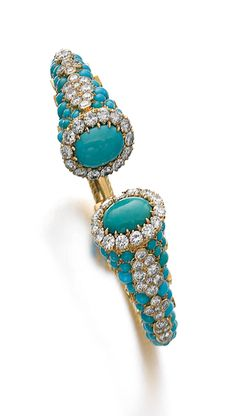 TURQUOISE AND DIAMOND TORQUE BRACELET, CARTIER, CIRCA 1960 Each terminal set with a cabochon turquoise framed with brilliant-cut diamonds   The Silver Pen