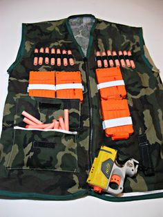 Nerf Gun Vest- I just may need to learn to sew so I can my my son one of these for Christmas.
