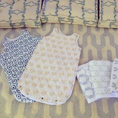 Baby sacs and baby sheets for the ecru Lil Ones available only today at Dar Al Funoon. #ecru #thelilones #blockprint #floorpillow #dhurrie