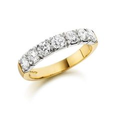 18ct yellow gold diamond eternity ring. Seven brilliant-cut diamonds set in platinum on an 18ct yellow gold band. Total diamond weight 0.71ct, F colour VS clarity.