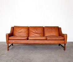 Design history: Sofa Model 965  Designer: Fredrik Kayser ( Norway , 1928 )  Design year: 1965   Maker: Vatne Lenestolfabrikk , Norway. Down cushions/leather/rosewood.