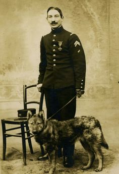 A French soldier of the 151st Régiment d'Infanterie posing with his dog, 1917.